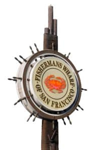 Large Fisherman's Wharf of San Francisco Sign against a bright blue sky